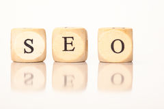 SEO spelled with dice letters Stock Photos