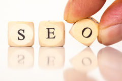 SEO spelled with dice letters Royalty Free Stock Image