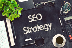SEO Strategy Concept on Black Chalkboard. 3D Rendering. Stock Image