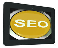 SEO Tablet Shows Increase Search Engine Optimization Royalty Free Stock Photography