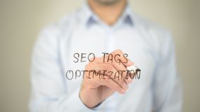 SEO Tags Optimization,  Man writing on transparent screen Royalty Free Stock Photography