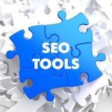 SEO Tools en rompecabezas azul Foto de archivo libre de regalías