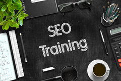 SEO Training Handwritten on Black Chalkboard. 3D. Royalty Free Stock Photography
