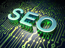 SEO web development concept: SEO on circuit board Royalty Free Stock Images