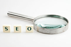 SEO word and magnifying glass Royalty Free Stock Photo