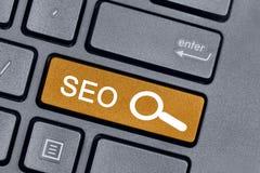 Seo-Wort auf Tastaturknopf Stockfotografie