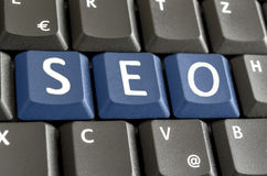 SEO written with blue keyboard buttons Royalty Free Stock Photo