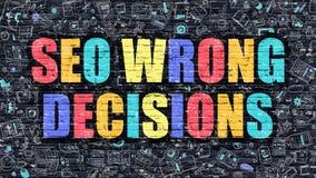 SEO Wrong Decisions en la pared de ladrillo oscura Fotografía de archivo libre de regalías