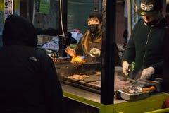 Seomun Market Street Food Vendor Using Torch royalty free stock photography