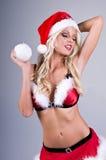 Señora atractiva Santa With Snowball Imágenes de archivo libres de regalías
