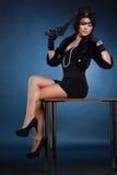 Señora elegante con una pistola Imágenes de archivo libres de regalías