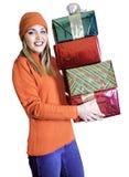 Señora joven con cuatro regalos (la Navidad/cumpleaños) Fotos de archivo