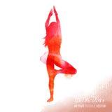 Señora joven en clase de la yoga Foto de archivo