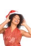 Señora étnica emocionada feliz Claus en sombrero de la Navidad Fotos de archivo libres de regalías