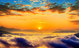 Seoraksan mountains is covered by morning fog and sunrise in korea. Royalty Free Stock Images