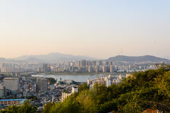 Seoul city with river and mountains in evening time Royalty Free Stock Image