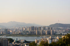 Seoul city with river and mountains in evening time Royalty Free Stock Photo