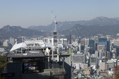 Seoul city view. General view of seoul, South Korea, with modern buildings in the foreground and mountains in the background, and a communications mast central Stock Images