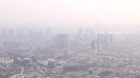 Seoul cityscape in smog. Overlook panorama from Namsan Mountain. Buildings in thick fog stock footage