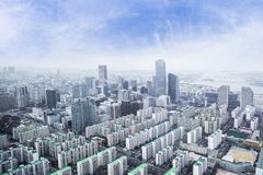 Seoul cityscapes, skyline, high rise office buildings and skyscr. Apers in Seoul city, winter daylight, top view in winter, Seoul, Republic of Korea, in mist Royalty Free Stock Photo