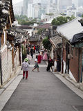 Seoul Hanok Village. Tourists stroll along a streets of a traditional Hanok village in downtown Seoul Royalty Free Stock Photo