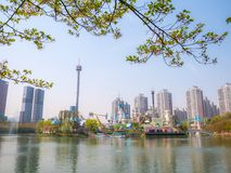 SEOUL, KOREA - APRIL 17, 2018: Lotte World Seokchon Lake park and cherry blossom in Summer seasson in Seoul, South Korea on April royalty free stock photography