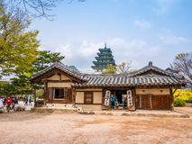 SEOUL, KOREA - APRIL 15 2018: National Folk Museum of South Korea located within the grounds of the Gyeongbokgung Palace visitors royalty free stock images