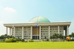 SEOUL, KOREA - AUGUST 14, 2015: Building of the National Assembly Proceeding Hall - South Korean capitol - located on Yeouido isla. SEOUL, KOREA - AUGUST 14 Royalty Free Stock Image