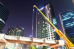 SEOUL, KOREA - AUGUST 10, 2015: Engineers assembling a new bridge at night in the center of Seoul, South Korea Royalty Free Stock Image