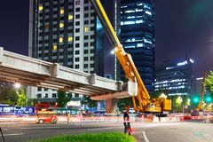 SEOUL, KOREA - AUGUST 10, 2015: Engineers assembling a new bridge at night in the center of Seoul, South Korea Royalty Free Stock Photos