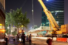 SEOUL, KOREA - AUGUST 10, 2015: Engineers assembling a new bridge at night in the center of Seoul, South Korea Royalty Free Stock Photo