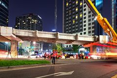 SEOUL, KOREA - AUGUST 10, 2015: Engineers assembling a new bridge at night in the center of Seoul, South Korea Stock Photos
