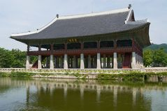 Gyeongbokgung dining pavilion with a pond at the famous Gyeongbokgung Palace in Seoul, Korea. royalty free stock image