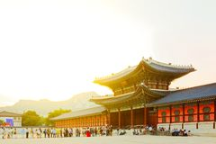 SEOUL, KOREA - AUGUST 14, 2015: Lots of people entering Gyeongbokgung Palace - the main royal palace of the Joseon dynasty - Seoul Royalty Free Stock Photography