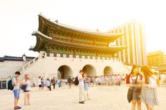 SEOUL, KOREA - AUGUST 14, 2015: Lots of people walking inside Gyeongbokgung Palace - the main royal palace of the Joseon dynasty - Stock Photography