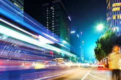 SEOUL, KOREA - AUGUST 10, 2015: Man waiting for a public bus at night at Dongdaemun district of Seoul, South Korea Royalty Free Stock Images