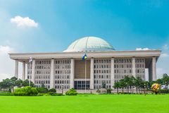 SEOUL, KOREA - AUGUST 14, 2015: Famous building of the National Assembly Proceeding Hall - South Korean capitol - located on Yeoui. SEOUL, KOREA - AUGUST 14 Stock Photography
