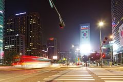 SEOUL, KOREA - AUGUST 10, 2015: People crossing crosswalk at night near Dongdaemun area of Seoul, South Korea Stock Photography