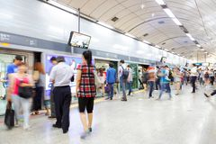 SEOUL, KOREA - AUGUST 12, 2015: People standing in the line on a subway platform and waiting for their train to come - Seoul, Sout Stock Image