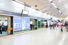 SEOUL, KOREA - AUGUST 12, 2015: People taking subway train after rush hour in Seoul, South Korea Royalty Free Stock Photo