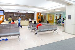 SEOUL, KOREA - AUGUST 12, 2015: People waiting for their turn at registration desk of Severance hospital of Yonsei University - ve Stock Photography