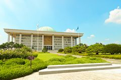 SEOUL, KOREA - AUGUST 14, 2015: Photo zone of National Assembly Proceeding Hall building - South Korean capitol - located on Yeoui. SEOUL, KOREA - AUGUST 14 Royalty Free Stock Photography