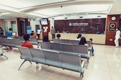 SEOUL, KOREA - AUGUST 12, 2015: Several people waiting at registration desk of Yonsei University Cancer Hospital - very prestigiou. SEOUL, KOREA - AUGUST 12 Royalty Free Stock Photography