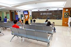 SEOUL, KOREA - AUGUST 12, 2015: Several people waiting at registration desk of Severance hospital of Yonsei University - very pres Royalty Free Stock Photography
