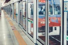SEOUL, KOREA - AUGUST 12, 2015: Subway train aproaching to an empty platform of Yongsan station - Seoul, Republic of Korea. SEOUL, KOREA - AUGUST 12, 2015 Royalty Free Stock Photography