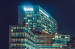 SEOUL, KOREA - AUGUST 12, 2015: New campus of Yonsei Univercity Cancer Center at night - writing on the building means. SEOUL, KOREA - AUGUST 12, 2015: Yonsei Stock Photography
