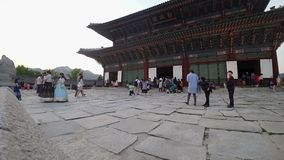 SEOUL, KOREA - MAY 29, 2018: Timelapse of Visitors in Traditional Costumes at Gyeongbokgung Palace