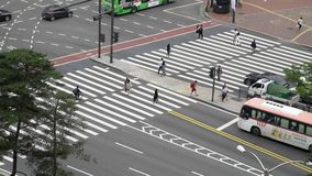 Seoul, Korea - May 29, 2018: top view of pedestrians crossing the road at intersection. Shot with a sony a6300 fps29,97 4k stock footage