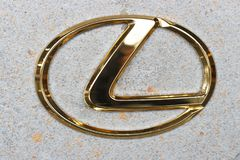 Seoul - 04.27.19: Lexus golden sign logo on a wall close-up royalty free stock image