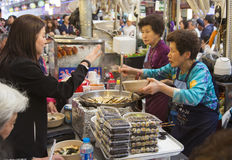 Seoul, Republic of Korea - 5 May 2015: People queing and tasting Royalty Free Stock Image
